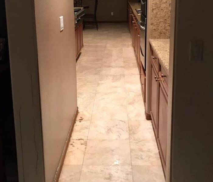 Hallway with wet floors.