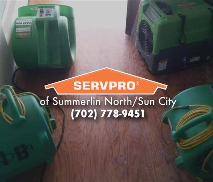 Four green SERVPRO air movers.