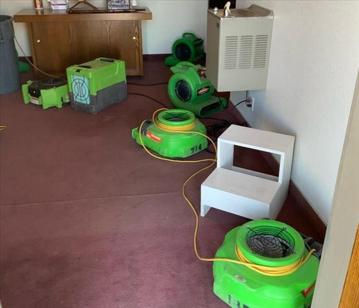 Carpet room with green air movers.