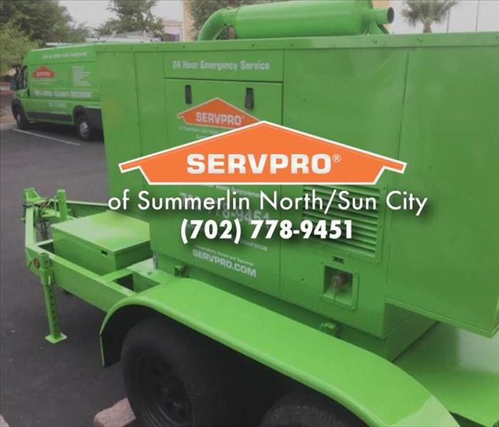 Large green SERVPRO equipment.