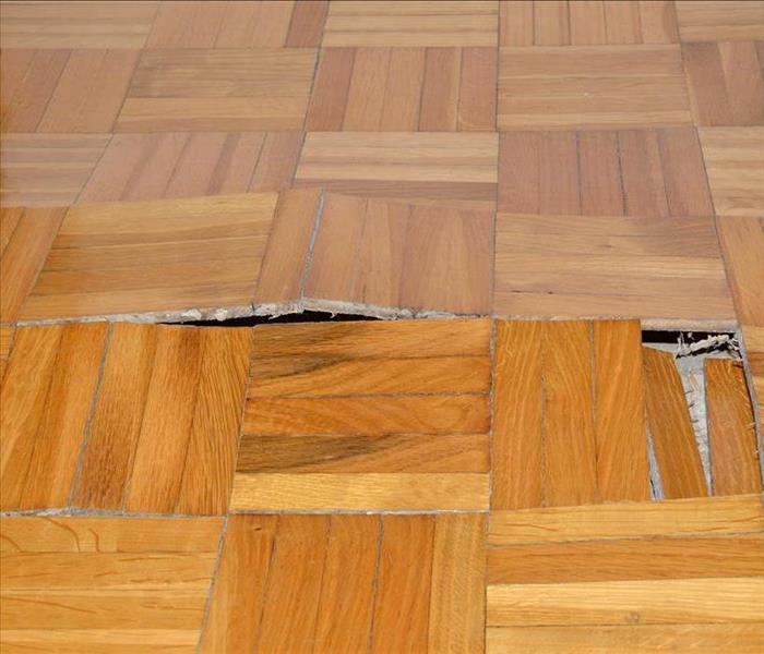 Warped wooden floor from water damage