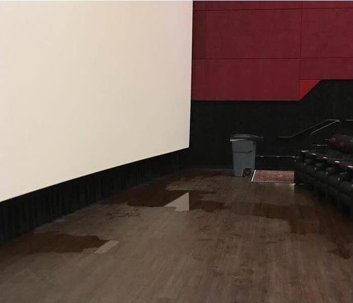 Water damage on a floor of a theater